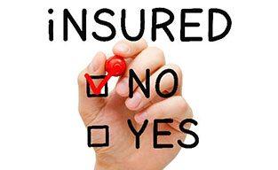 No insurance no problem hand putting check on No Insured